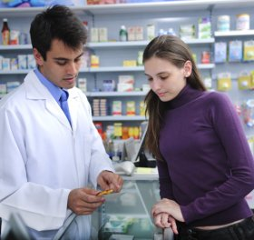 pharmacist advising client