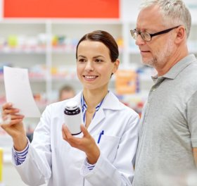 pharmacist and senior customer checking a prescription
