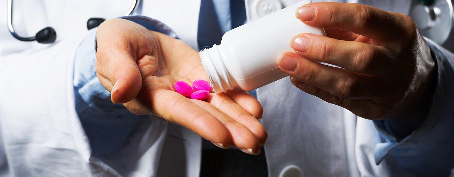 pharmacist hand with medicine