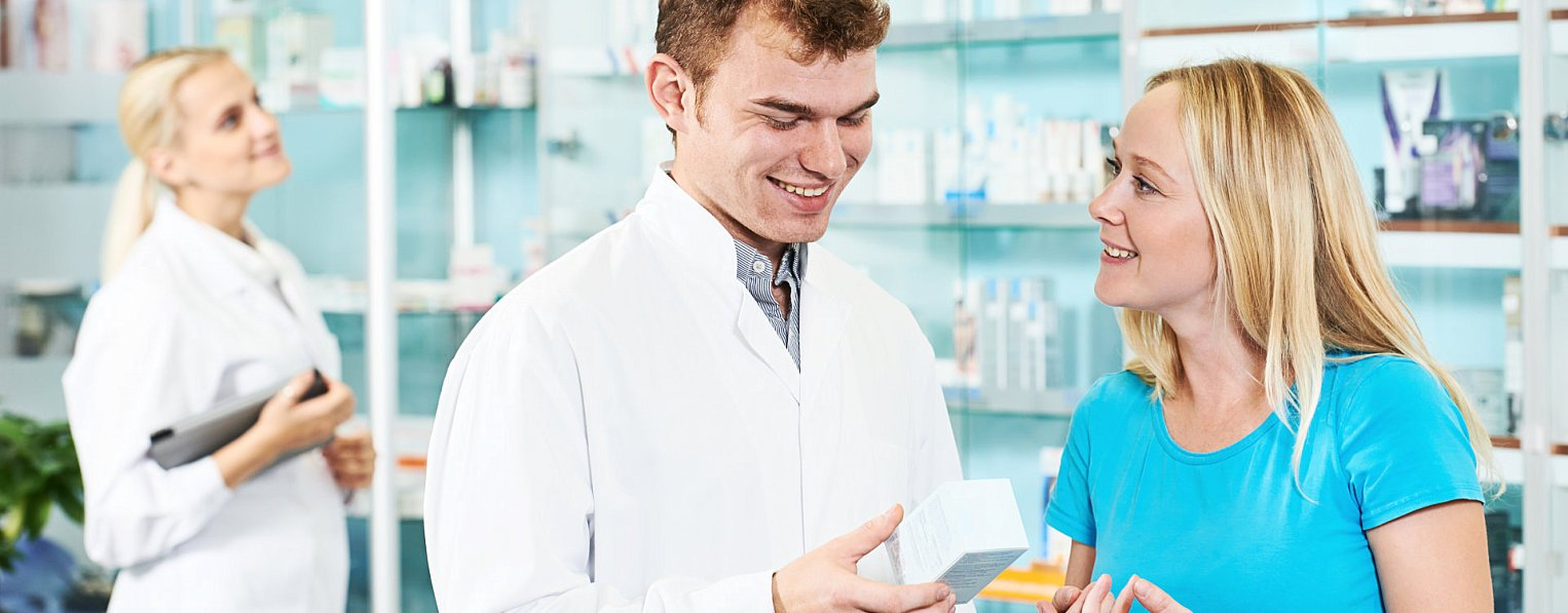 woman talking with a male pharmacist
