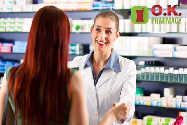 a female pharmacist talking to a female customer